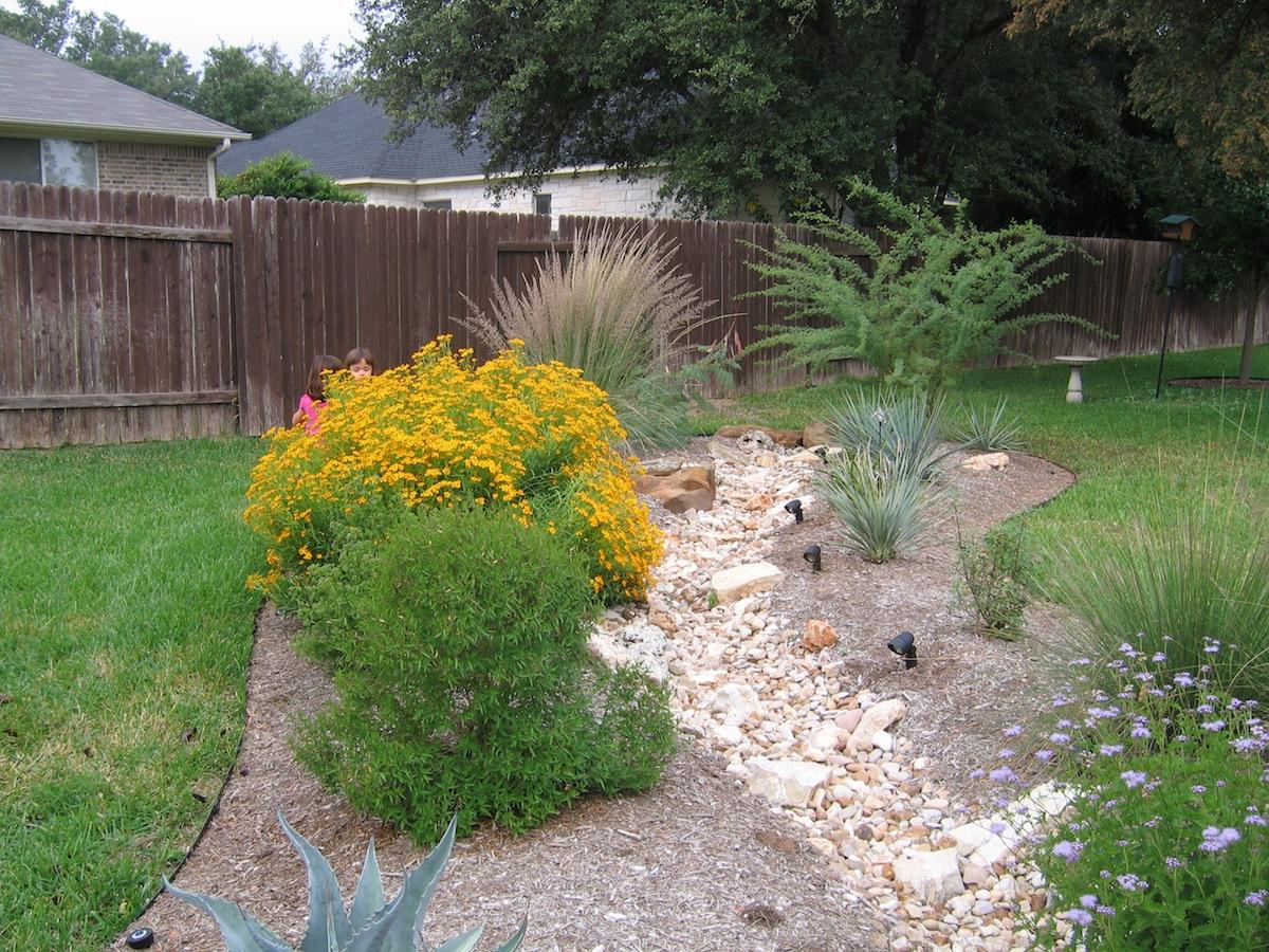 Decorative Dry Creek Bed Red Sun Landscape Design